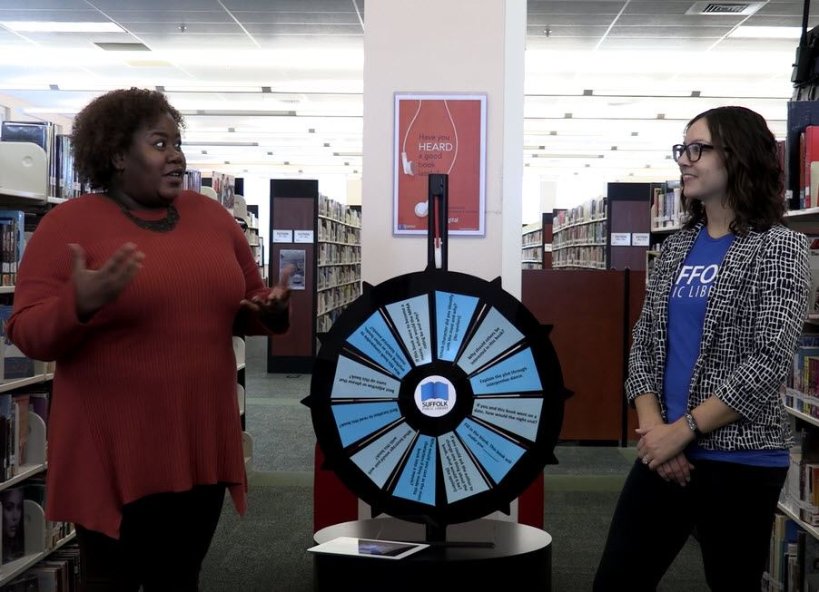 Face the Wheel December 2018 Still Shot featuring host and contestant with wheel